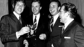 """Cheers!"" - Udo Jürgens and Peter Alexander with Bertelsmann executives Egmont Lüftner and Friedel Schmidt (left to right)"