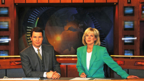 News anchors Peter Kloeppel and Ulrike von der Groeben, 1998