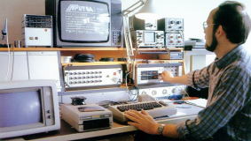 A Sonopress staff member testing software before it is replicated, 1985