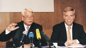 Mark Wössner (l) and Frank Wössner announce the Random House takeover