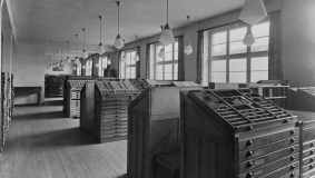 The manual composing room with frames in the 1930s